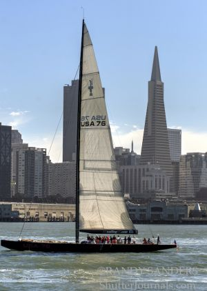 Boaters pass in front of the TransAmerica building
